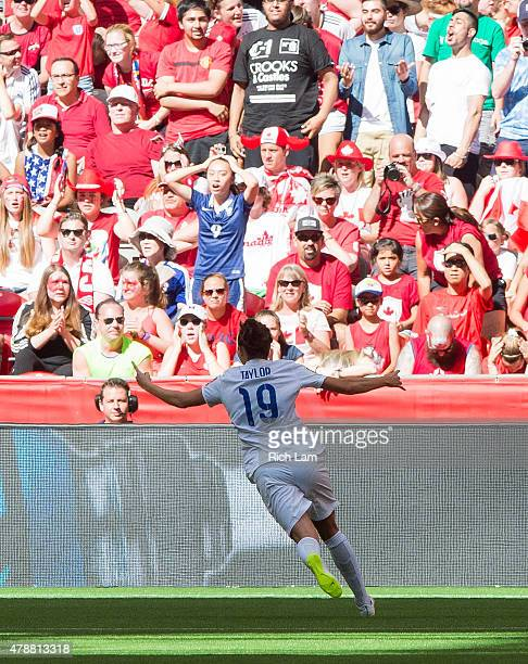 Jodie Taylor of England celebrates after scoring a goal against Canada during the FIFA Women's World Cup Canada 2015 Quarter Final match between the...