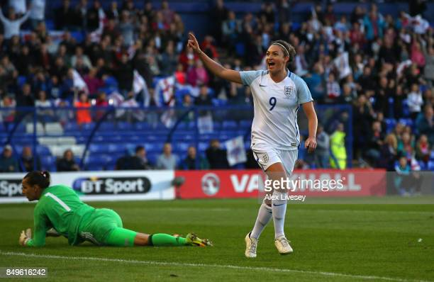 Jodie Taylor of England celebrates after scoring the second goal during the FIFA Women's World Cup Qualifier between England and Russia at Prenton...