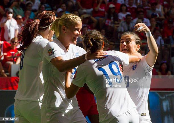 Jodie Taylor of England celebrates her goal against Canada with teammates Karen Carney and Steph Houghton during the FIFA Women's World Cup Canada...
