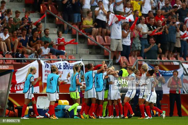 Jodie Taylor of England celebrates with team mates after she scores the first goal of the game during the UEFA Women's Euro 2017 Group D match...