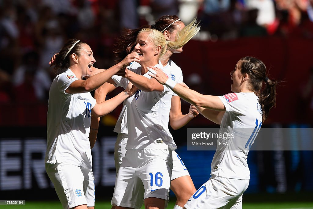 Jodie Taylor of England celebrates with team mates Katie Chapman and Karen Carney during the FIFA Women's World Cup 2015 Quarter Final match between...