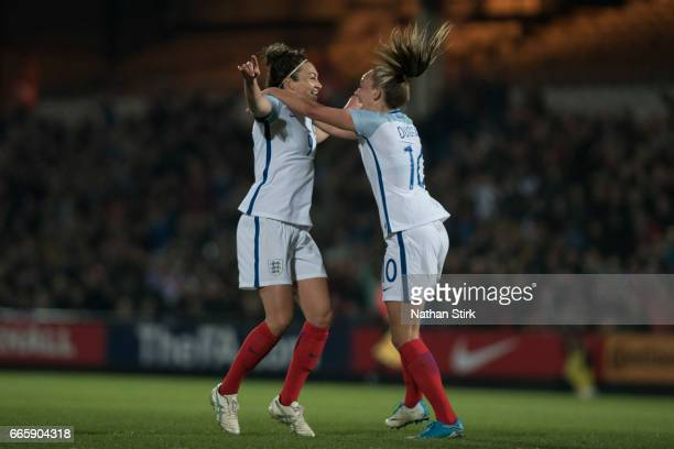 Jodie Taylor of England celebrates with Toni Duggan after scoring the opening goal during the Women's International Friendly match between England...