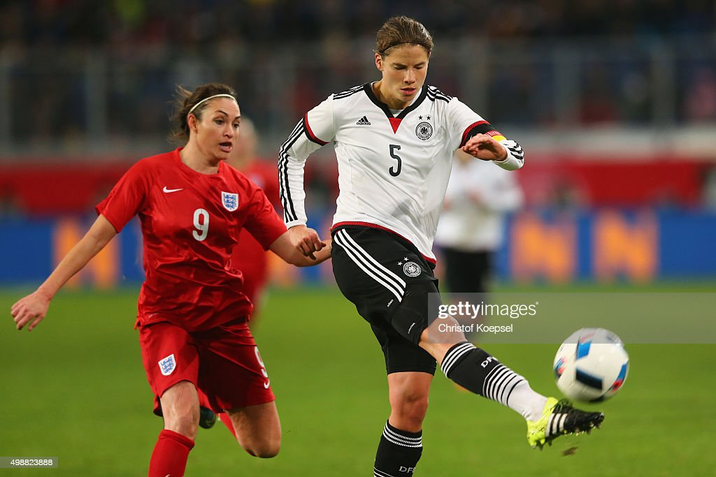 Jodie Taylor of England challenges Annike Krahn of Germany during the Women's International Friendly match between Germany and England at...