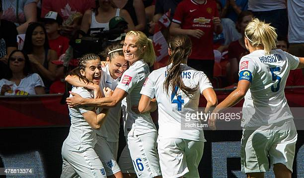 Jodie Taylor of England is congratulates by team mates Katie Chapman Fara Williams Steph Houghton and Karen Carney after scoring against Canada...