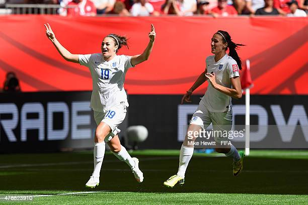 Jodie Taylor of England is congratulted by team mate Jill Scott of England after giving her side the lead during the FIFA Women's World Cup 2015...
