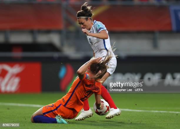 Jodie Taylor of England is tackled by Desiree van Lunteren of The Netherlands during the UEFA Women's Euro 2017 Semi Final match between Netherlands...