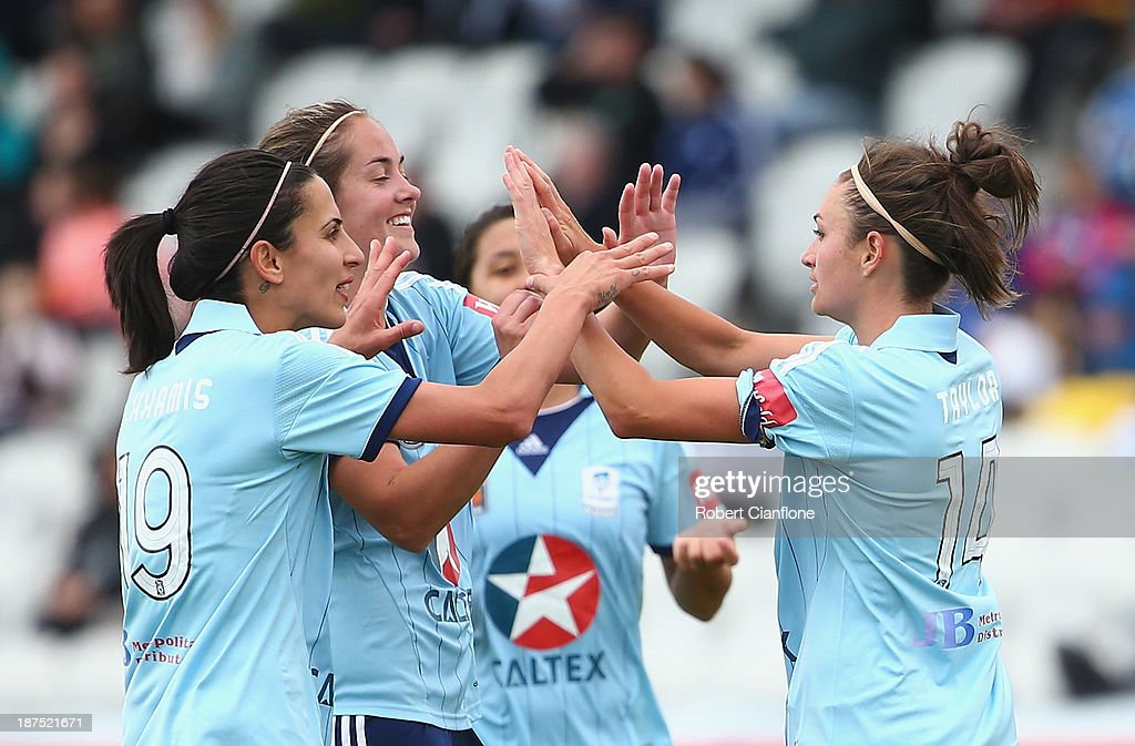 Jodie Taylor of Sydney FC celebrates her goal with team mates during the round one W-League match between the Melbourne Victory and Sydney FC at Lakeside Stadium on November 10, 2013 in Melbourne, Australia.