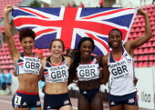Jodie Williams Rachel Johncock Annie Tagoe and Corinne Humphreys of Great Britain celebrate silver in the Women's 4x100m Relay during day four of The...