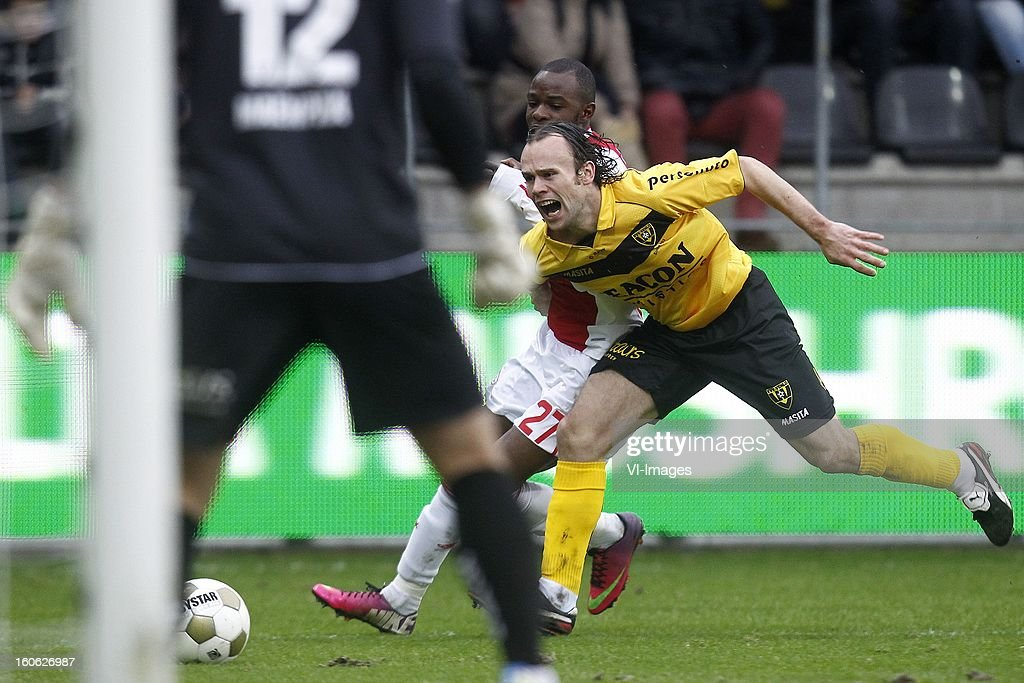 Jody Lukoki of Ajax (L), Niels Fleuren of VVV-Venlo (R) during the Dutch Eredivisie match between VVV-Venlo and Ajax Amsterdam at stadium De Koel on february 3, 2013 in Venlo, The Netherlands