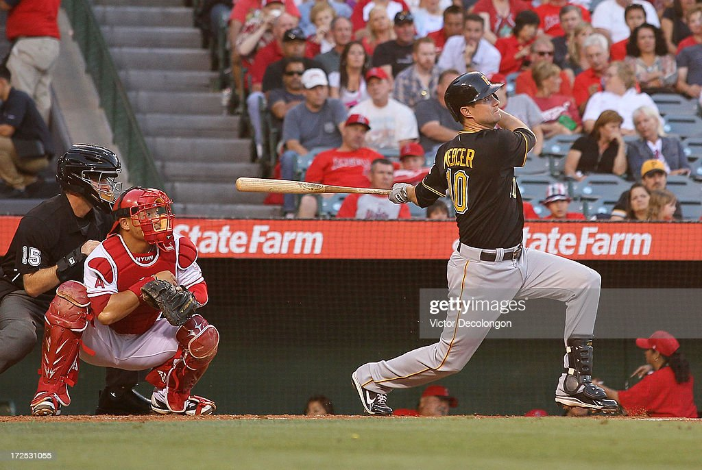 Jody Mercer #10 of the Pittsburgh Pirates hits a two-run homerun to left field in the second inning during the MLB game against the Los Angeles Angels of Anaheim at Angel Stadium of Anaheim on June 21, 2013 in Anaheim, California. The Pirates defeated the Angels 5-2.