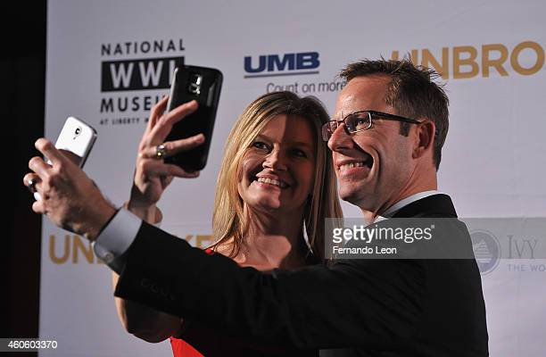 Jody Parks and Bob Kimbrough take a selfie before the private screening ot 'Unbroken' at the National World War I Museum on December 16 2014 in...