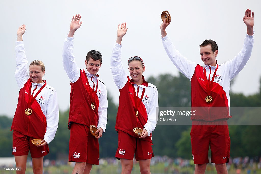 Jody Simpson Jonathan Brownlee Vicky Holland and Alistair Brownlee of England pose with their Gold medal on the podium after winning the mixed team...