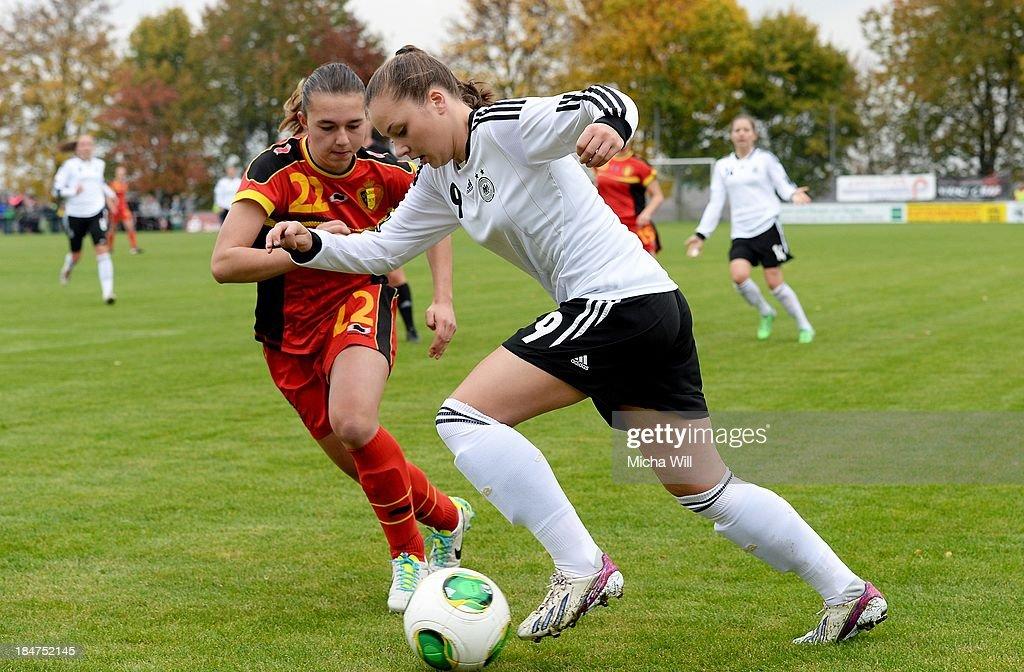 Jody Vangheluewe (L) of Belgium challenges Laura Widak of Germany during the U17 Girls Euro Qualifier match between Germany and Belgium at Bioenergie-Arena on October 16, 2013 in Grossbardorf, Germany.