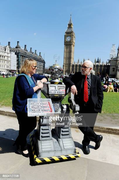 Jody Williams Nobel Peace Laureate and Professor Noel Sharkey Chairman for the International Committee for Robot Arms Control stand with a robot in...