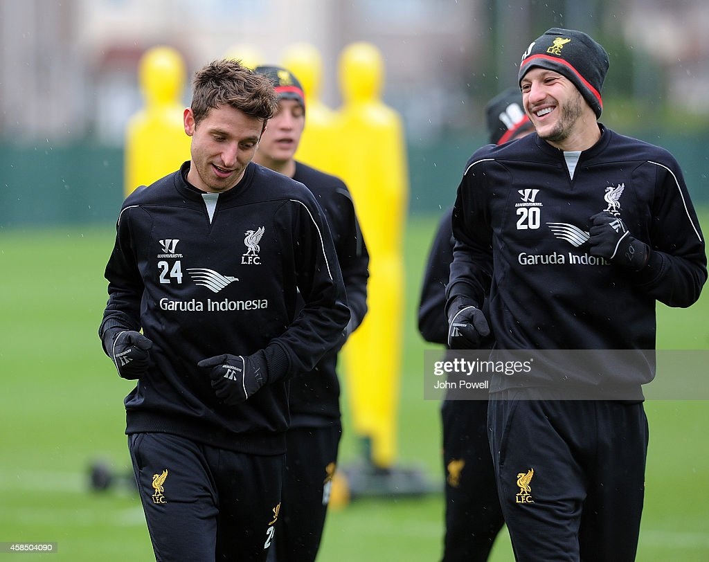 Joe Allen and Adam Lallana of Liverpool in action during a training session at Melwood Training Ground on November 6, 2014 in Liverpool, England.