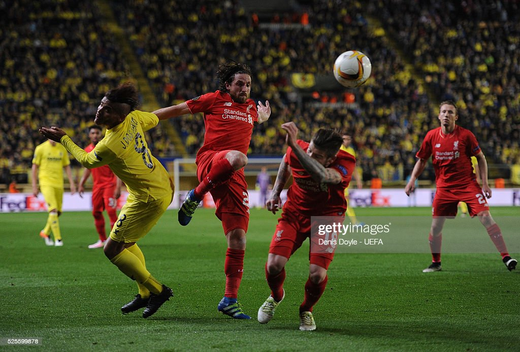 Joe Allen (#18) and Alberto Moreno of Liverpool battle for the ball against Jonathan Dos Santos of Villarreal CF during the Europa League Semi Final first leg match between Villarreal CF and Liverpool at El Madrigal stadium on April 28, 2016 in Villarreal, Spain.