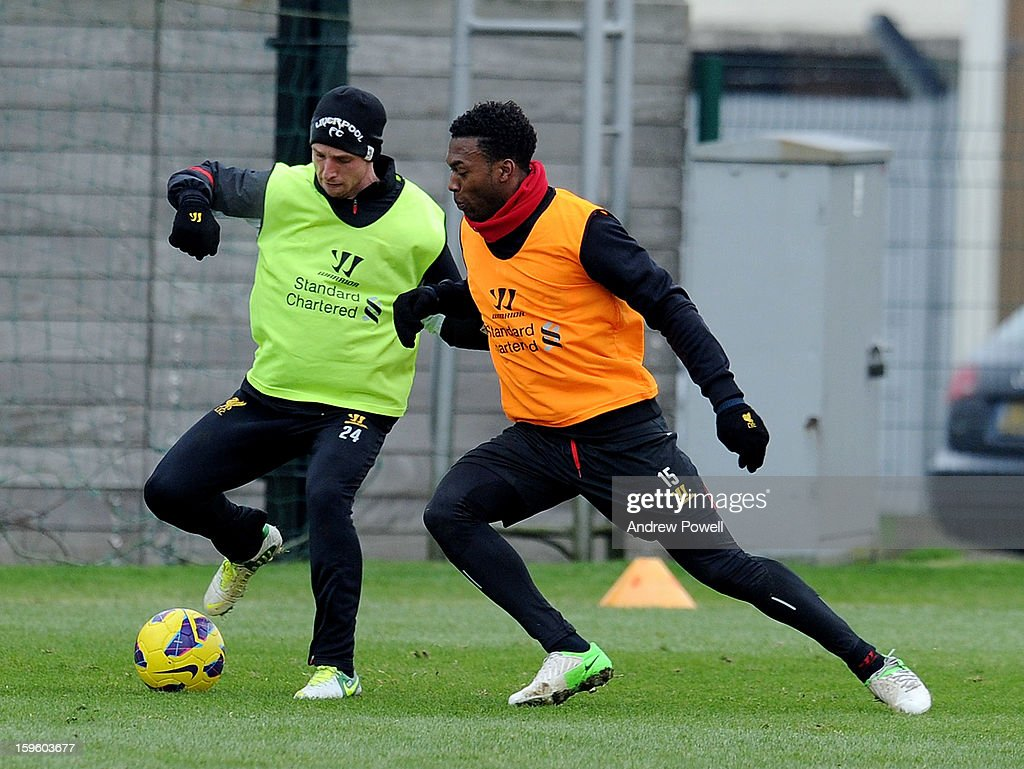 Joe Allen and Daniel Sturridge of Liverpool in action during a training session at Melwood Training Ground on January 17, 2013 in Liverpool, England.