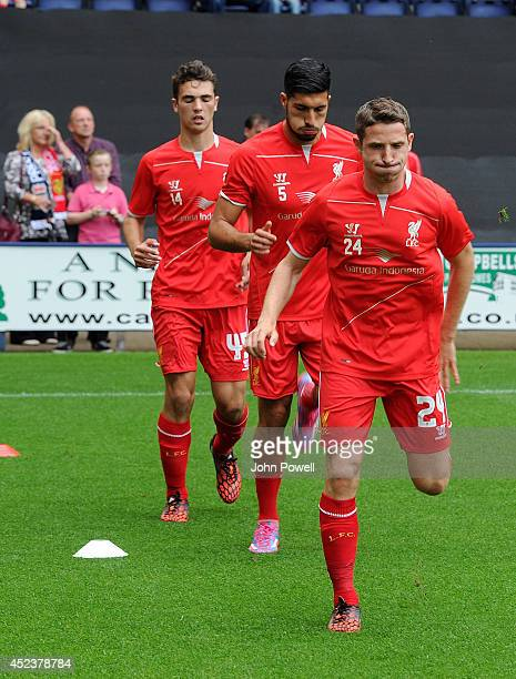 Joe Allen and Emre Can of Liverpool warms up before the Pre Season friendly match between Preston North End and Liverpool at Deepdale on July 19 2014...