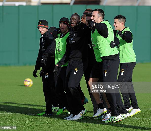 Joe Allen Lucas Leiva Mario Balotelli Kolo ToureJose Enrique and Javier Manquilo of Liverpool during a training session at Melwood Training Ground on...