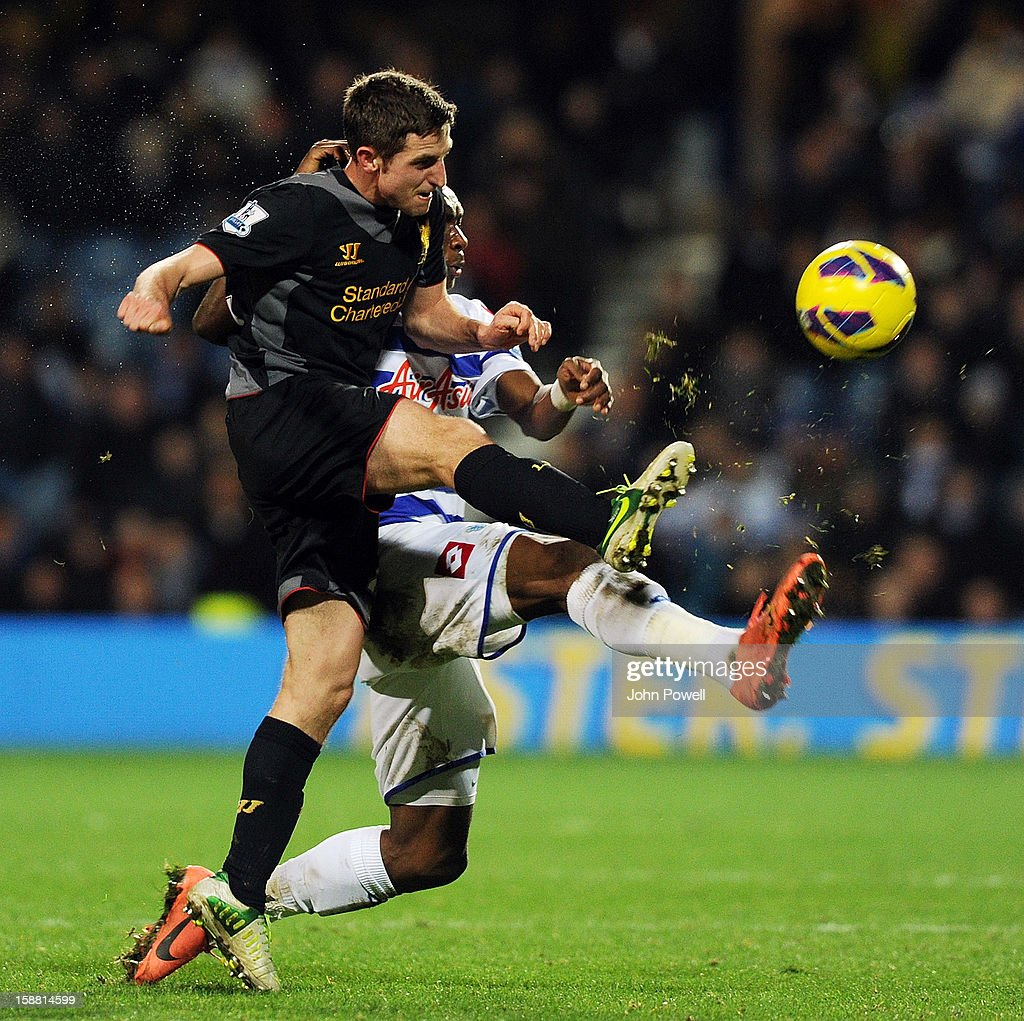 Joe Allen of Liverpool and Stephane Mbia of Queens Park Rangers during the Barclays Premier League match between Queens Park Rangers and Liverpool at Loftus Road on December 30, 2012 in London, England.