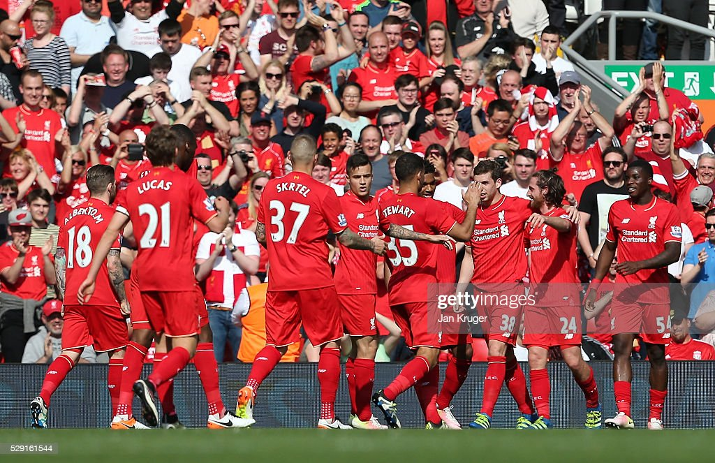Joe Allen of Liverpool (2R) celebrates with his team mates after scoring his side's first goal during the Barclays Premier League match between Liverpool and Watford at Anfield on May 8, 2016 in Liverpool, England.