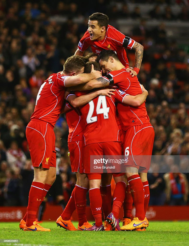 Joe Allen of Liverpool (24) celebrates with team mates as he scores their second goal during the Barclays Premier League match between Liverpool and Newcastle United at Anfield on April 13, 2015 in Liverpool, England.