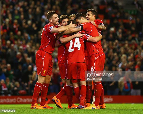 Joe Allen of Liverpool celebrates with team mates as he scores their second goal during the Barclays Premier League match between Liverpool and...