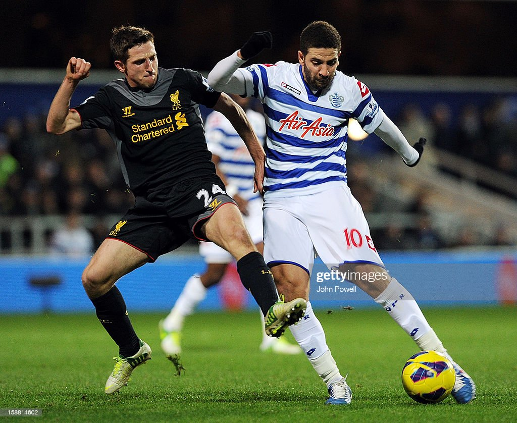 Joe Allen of Liverpool competes with Adel Taarabt of Queens Park Rangers during the Barclays Premier League match between Queens Park Rangers and Liverpool at Loftus Road on December 30, 2012 in London, England.