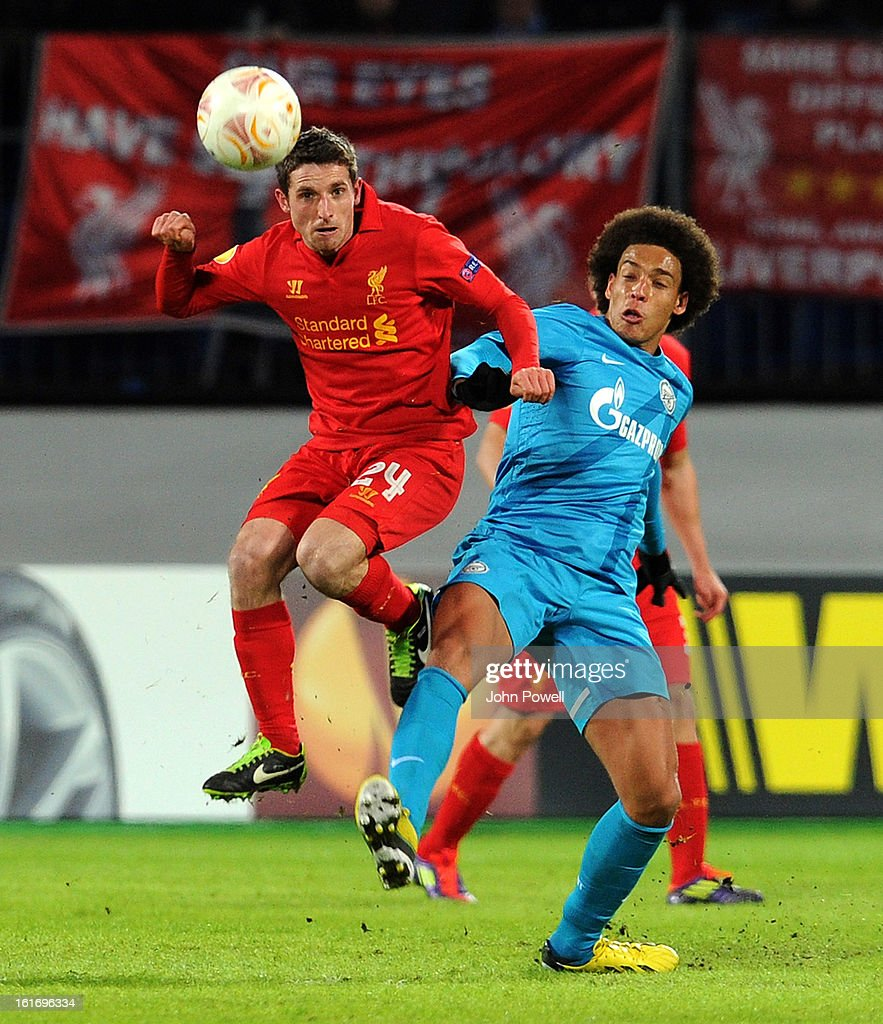 Joe Allen of Liverpool competes with Axel Witsel of FC Zenit St Petersburg during the UEFA Europa League round of 32 first leg match between FC Zenit St Petersburg and Liverpool on February 14, 2013 in Saint Petersburg, Russia.