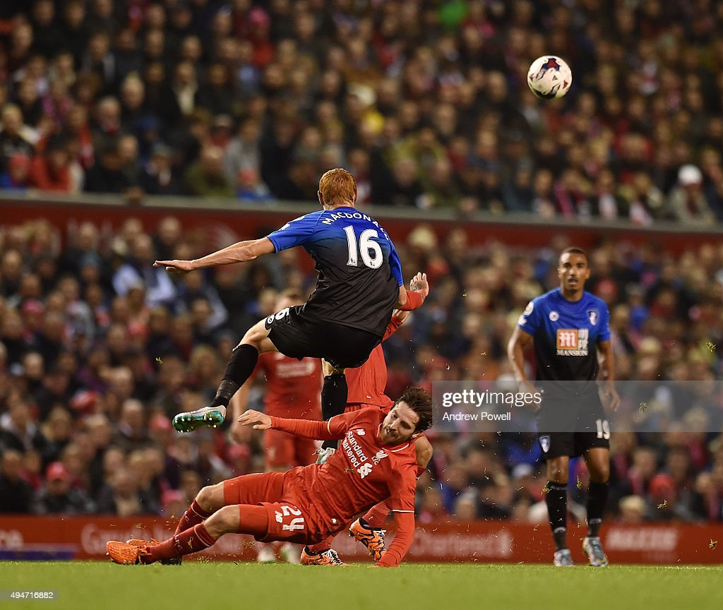 Joe Allen of Liverpool competes with Shaun MacDonald of AFC Bournemouth during the Capital One Cup Fourth Round match between Liverpool and AFC Bournemouth at Anfield on October 28, 2015 in Liverpool, England.