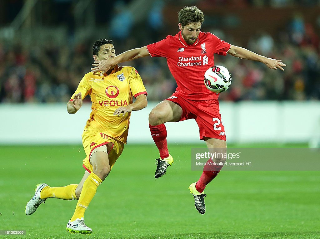 Joe Allen of Liverpool controls the ball ahead of Marcelo Carrusca of United during the international friendly match between Adelaide United and Liverpool FC at Adelaide Oval on July 20, 2015 in Adelaide, Australia.