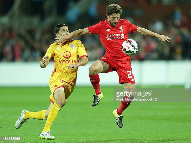 Joe Allen of Liverpool controls the ball ahead of Marcelo Carrusca of United during the international friendly match between Adelaide United and...
