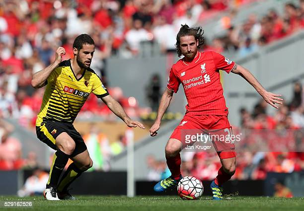 Joe Allen of Liverpool holds off Mario Suarez of Watford during the Barclays Premier League match between Liverpool and Watford at Anfield on May 8...