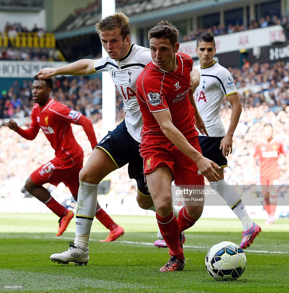 Joe Allen of Liverpool is brought down by <a gi-track='captionPersonalityLinkClicked' href=/galleries/search?phrase=Eric+Dier&family=editorial&specificpeople=9440610 ng-click='$event.stopPropagation()'>Eric Dier</a> of Tottenham Hotspur for a penalty during the Barclays Premier League match between Tottenham Hotspur and Liverpool at White Hart Lane on August 31, 2014 in London, England.