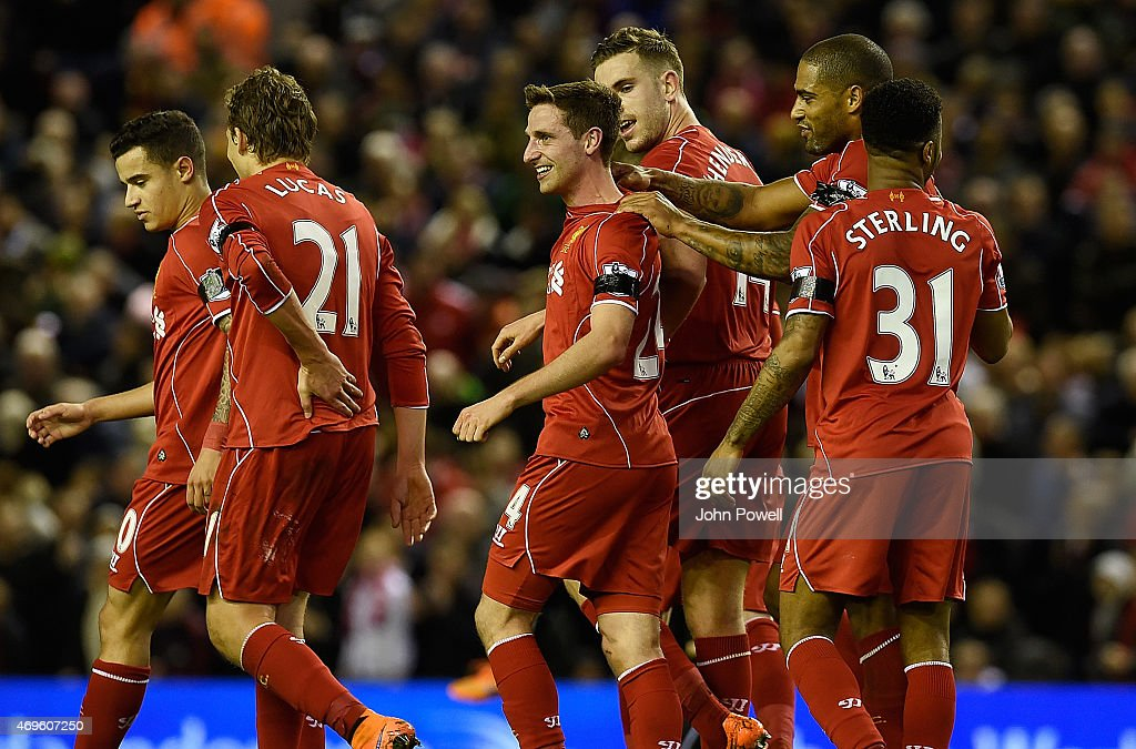 Joe Allen of Liverpool is congratulated after his goal during the Barclays Premier League match between Liverpool and Newcastle United at Anfield on April 13, 2015 in Liverpool, England.