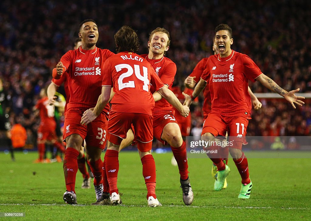 Joe Allen of Liverpool (24) is congratulated by team mates as he scores the decisive penalty in the shoot out during the Capital One Cup semi final second leg match between Liverpool and Stoke City at Anfield on January 26, 2016 in Liverpool, England. Liverpool win 6-5 on penalties after extra time.