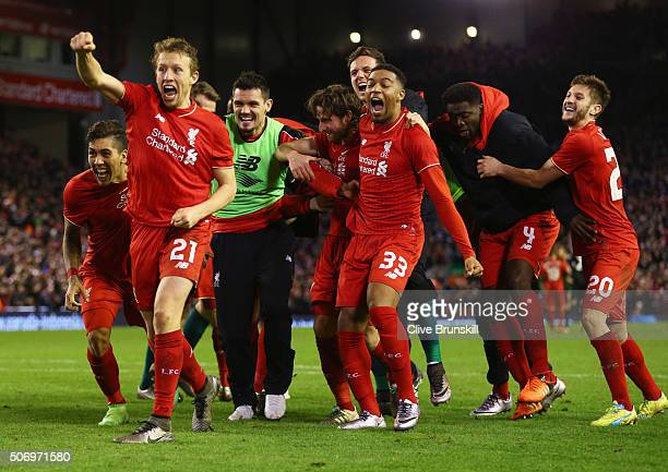 Joe Allen of Liverpool is congratulated by team mates as he scores the decisive penalty in the shoot out during the Capital One Cup semi final second...