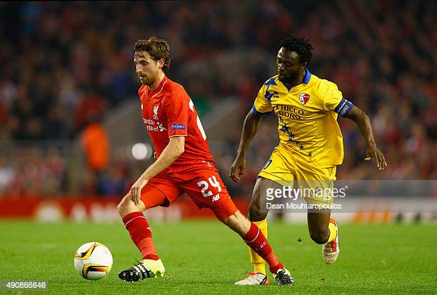 Joe Allen of Liverpool is marshalled by Laglais Kouassi of FC Sion during the UEFA Europa League group B match between Liverpool FC and FC Sion at...