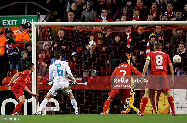 Joe Allen of Liverpool scores his team's second goal during the UEFA Europa League round of 32 second leg match between Liverpool FC and FC Zenit St...