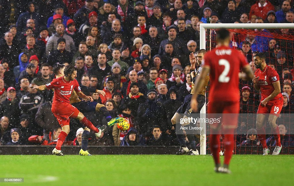 Joe Allen (2nd L) of Liverpool scores his team's third goal during the Barclays Premier League match between Liverpool and Arsenal at Anfield on January 13, 2016 in Liverpool, England.