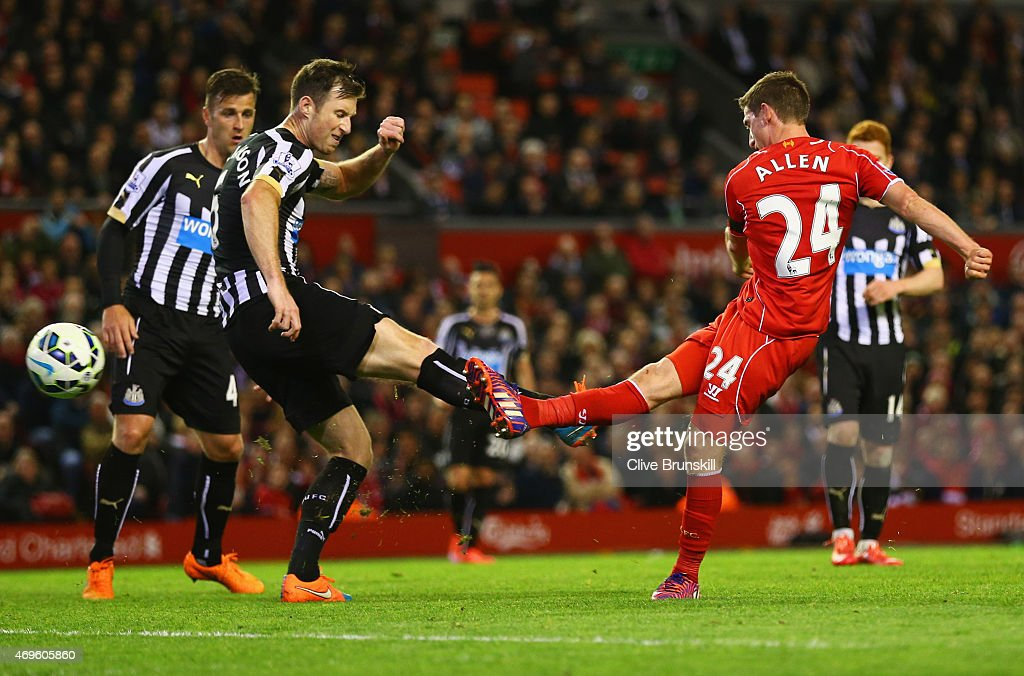 Joe Allen of Liverpool (24) shoots past Michael Williamson of Newcastle United to score their second goal during the Barclays Premier League match between Liverpool and Newcastle United at Anfield on April 13, 2015 in Liverpool, England.