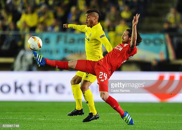 Joe Allen of Liverpool stretches to challenge Jonathan dos Santos of Villarreal during the UEFA Europa League semi final first leg match between...