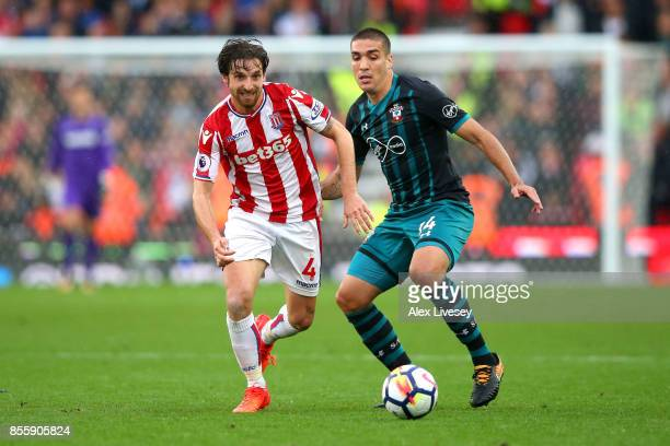 Joe Allen of Stoke City and Oriol Romeu of Southampton battle for possession during the Premier League match between Stoke City and Southampton at...