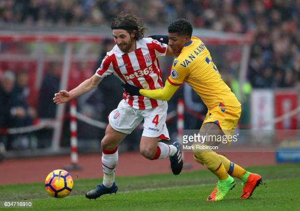 Joe Allen of Stoke City and Patrick van Aanholt of Crystal Palace compete for the ball during the Premier League match between Stoke City and Crystal...