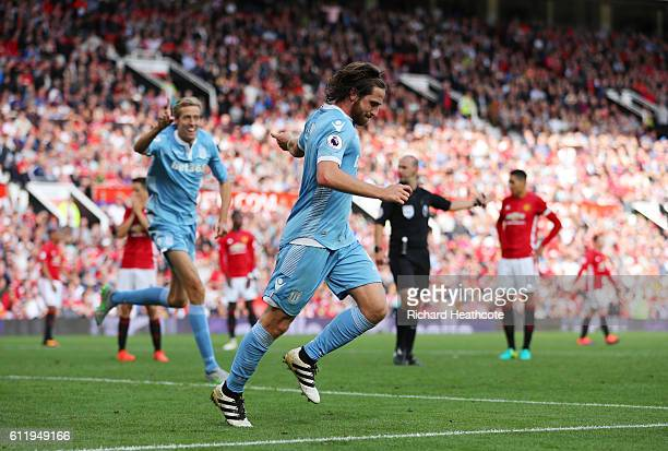 Joe Allen of Stoke City celebrates scoring his sides first goal during the Premier League match between Manchester United and Stoke City at Old...
