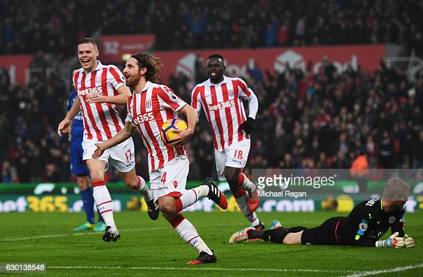 Joe Allen of Stoke City celebrates scoring his sides second goal during the Premier League match between Stoke City and Leicester City at Bet365...