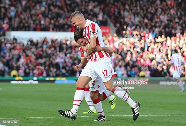 Joe Allen of Stoke City celebrates scoring his sides second goal with his team mate Ryan Shawcross of Stoke City during the Premier League match...