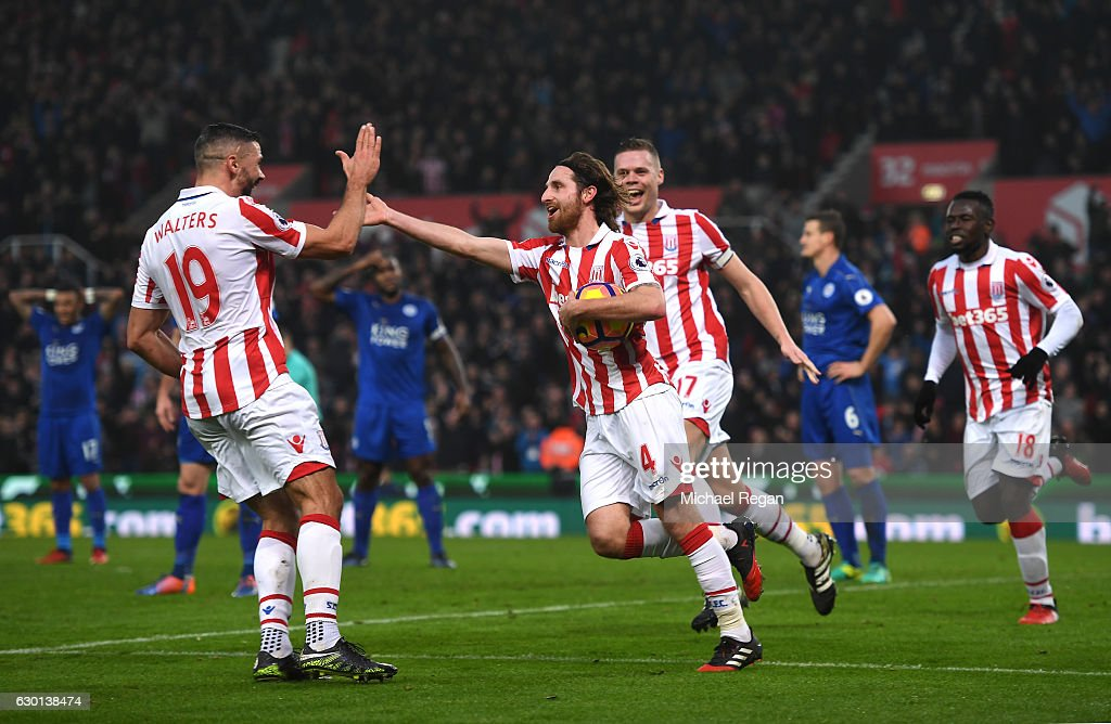 Joe Allen of Stoke City (C) celebrates scoring his sides second goal with Jonathan Walters of Stoke City (L) during the Premier League match between Stoke City and Leicester City at Bet365 Stadium on December 17, 2016 in Stoke on Trent, England.