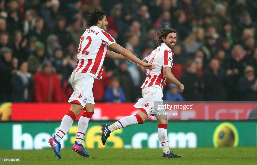 Joe Allen (R) of Stoke City celebrates scoring the opening goal with his team mate Ramadan Sobhi (L) during the Premier League match between Stoke City and Crystal Palace at Bet365 Stadium on February 11, 2017 in Stoke on Trent, England.