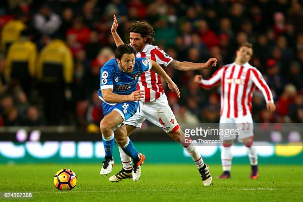 Joe Allen of Stoke City fouls Harry Arter of AFC Bournemouth during the Premier League match between Stoke City and AFC Bournemouth at Bet365 Stadium...